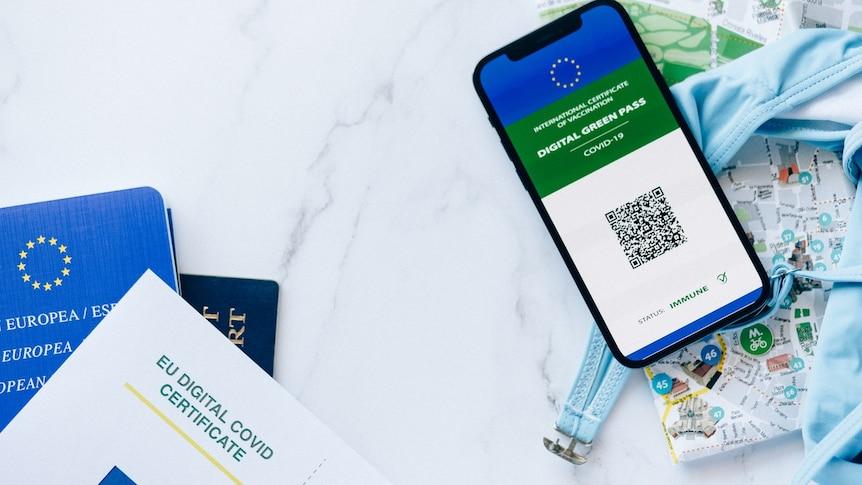 An EU passport and digital green pass for COVID-19 on a smart phone.