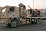 Islamic State of Iraq and the Levant (ISIS) fighters patrol on a vehicle in Tikrit.