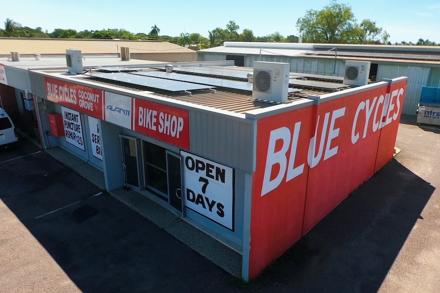 a drone photo of a store in a parking lot