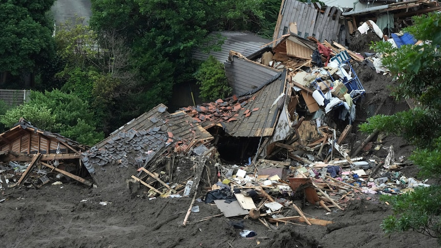 Image of crushed houses and debris surrounded in mud in Atami, Japan