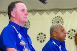 New Zealand's Prime Minister John Key attends a welcome ceremony with his Fiji counterpart Frank Bainimarama in Suva