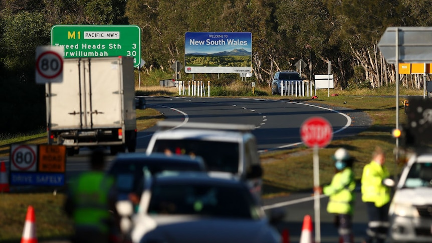 Play Audio. Cars stopped at the border between NSW and Queensland on the 24th July. Duration: 54 minutes 5 seconds