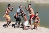 Members of the Barkindji dance troupe pose on the banks of the Darling River.
