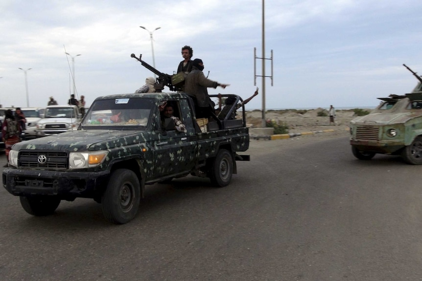 Militants patrol in the southern port city of Aden