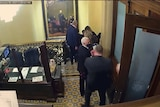 Former vice president Mike Pence ushered away from US senate chamber