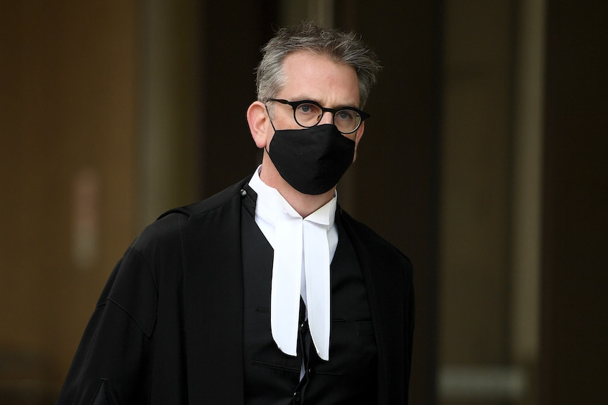 A man in black robes