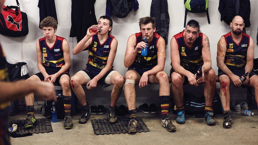 Crows players seated in rooms with bloodied knees for all