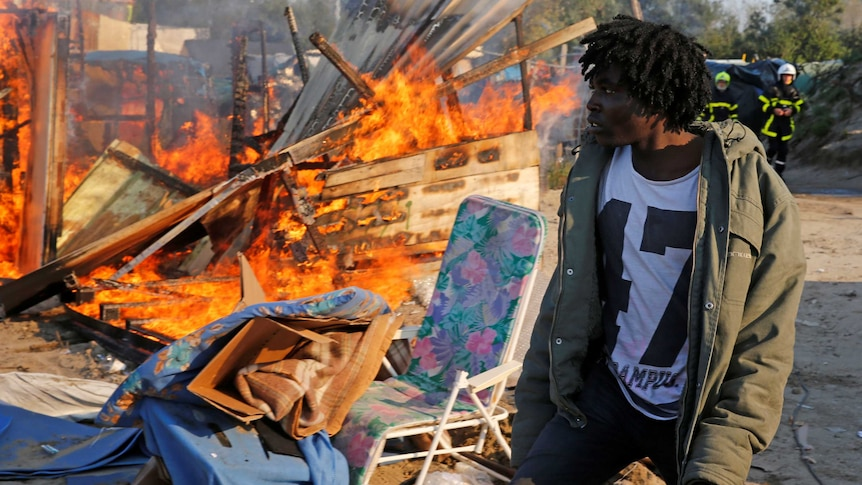 Some makeshift shelters have been burnt as crews begin dismantling the migrant camp in Calais.