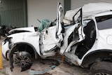 The wreckage of a car involved in a fatal crash inside a towing yard.