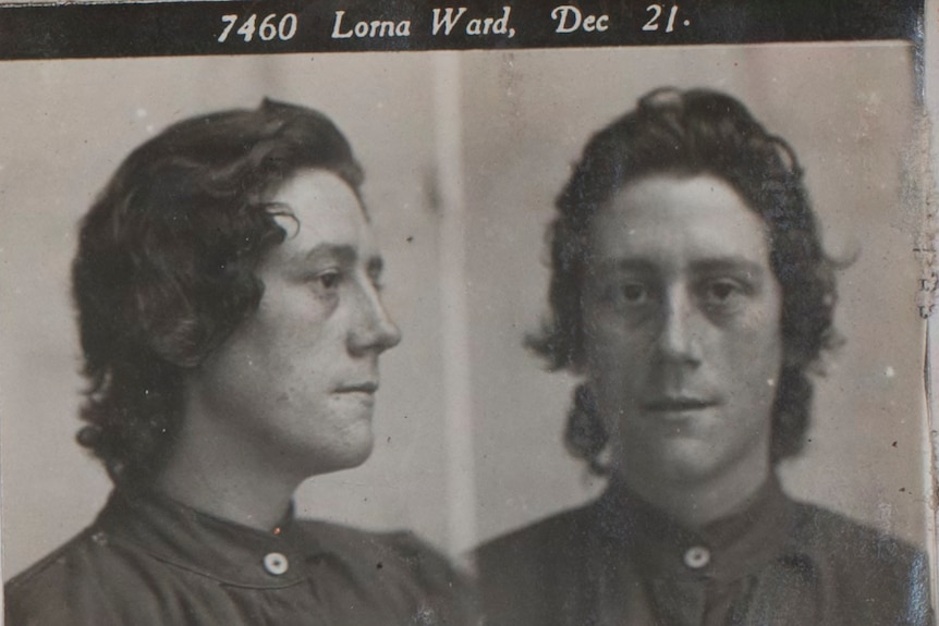 Black and white prison photo of young woman.