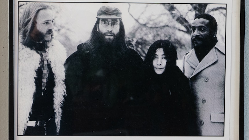 A historic photo of Ritchie Yorke with John Lennon, Yoko Ono and civil rights activistDick Gregory.