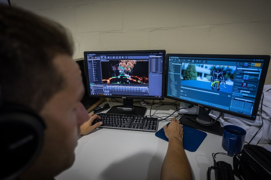 An inmate works on a computer, creating 3D animation.