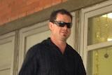Adam Taylor enters Burnie Magistrates Court