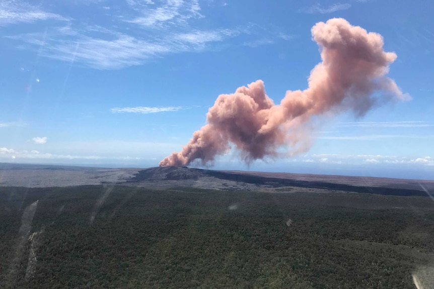 Smoke rises above a volcano in Hawaii