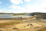 Drone photo of construction vehicles and workers at spillway of Paradise Dam near Bundaberg.