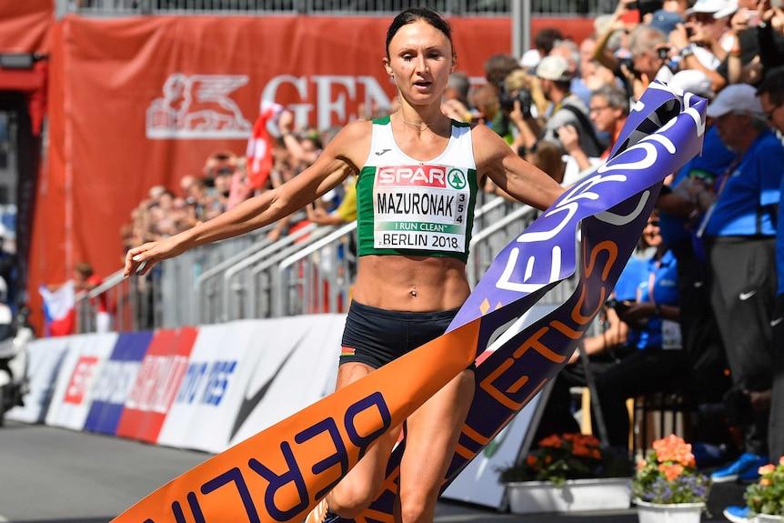 Volha Mazuronak crosses the finish line after winning the women's marathon at the European Championships.