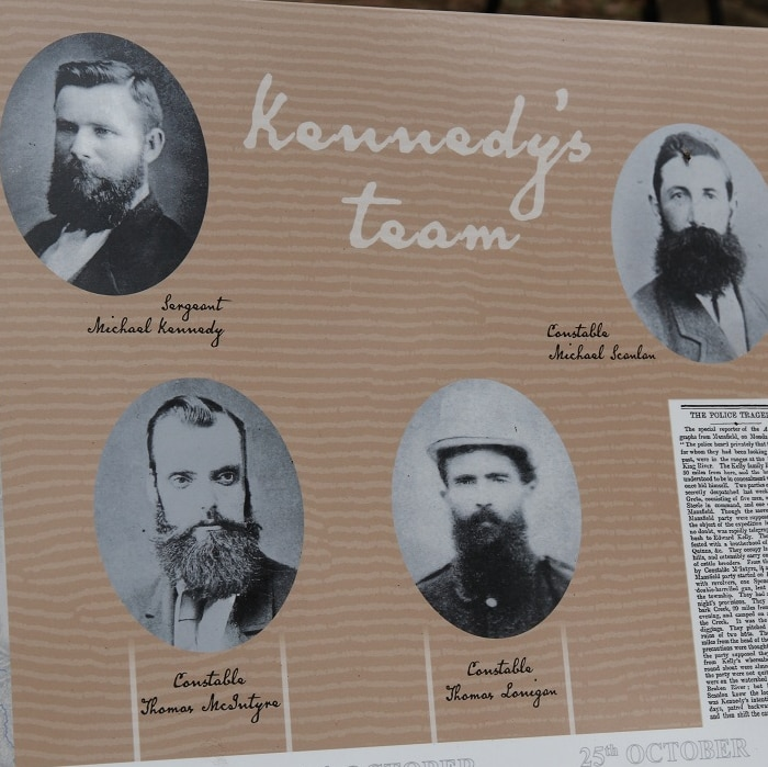 Signs at new Stringybark Creek Reserve Memorial show faces of four policemen involved in Kelly Gang shootout in 1878.