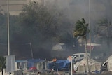 Smoke rises from burning tents at Pearl Square