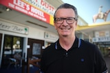 Publican Glenn Connell stands outside the Lee's Hotel in Ingham that is also known as 'The Pub with no beer'
