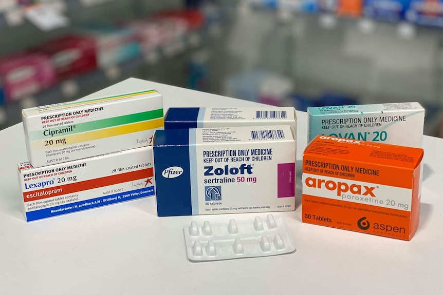 boxes of tablets on a pharmacy bench top