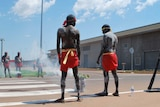 Inidgenous dancers in traditional body paint perform a smoking ceremony to open the new Darwin prison
