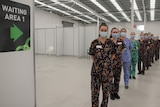Staff in Gorman-designed scrubs lined up in vaccination hub