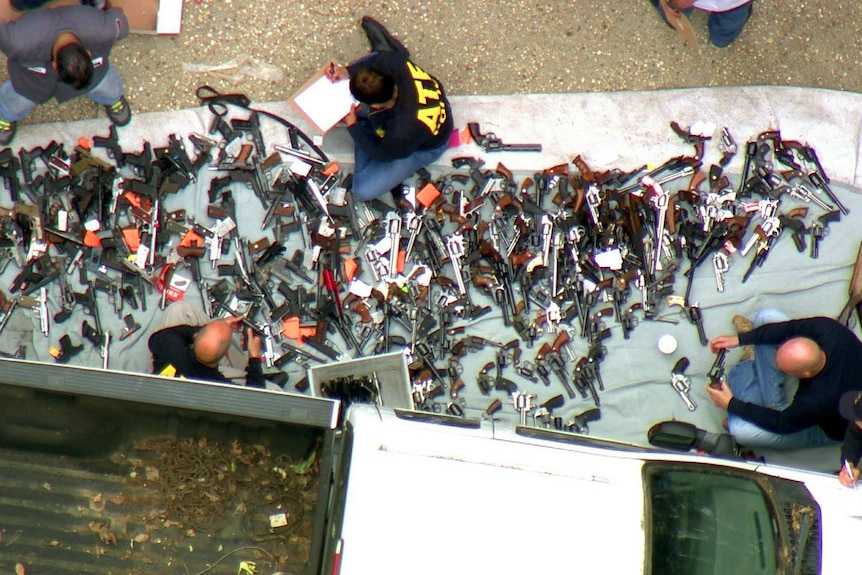 Authorities catalogue the massive stash of weapons