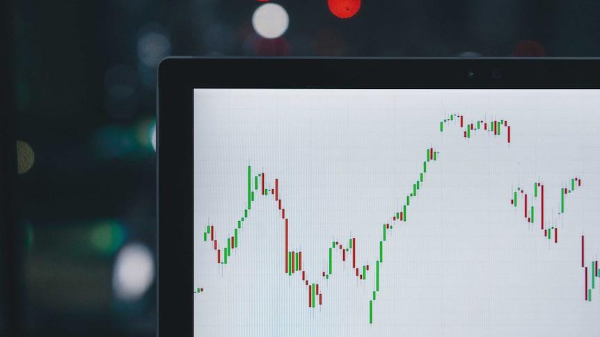 A chart of a volatile financial asset is seen on a laptop screen.