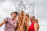 Artist Gabriele Trabucco and Helen Abrahams stand with the new sculpture
