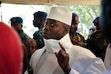 Gambia's presidentYahyaJammehshows his inked finger before voting in Banjul, Gambia