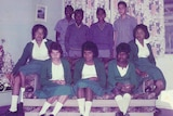 Indigenous teenagers in school uniform in two rows, boys at the back, girls at front.
