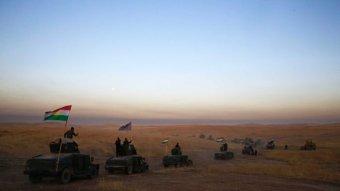 Kurdish convoy crosses the desert in Iraq.