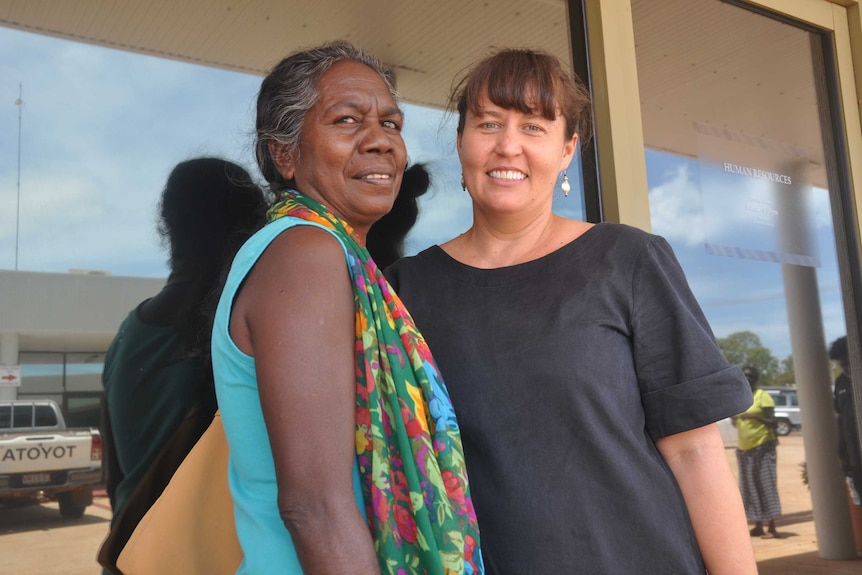 Two women standing outside a clinic