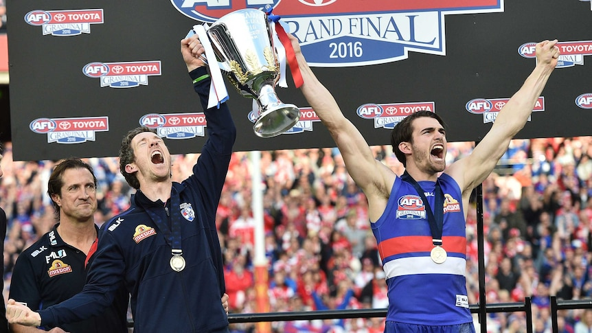Western Bulldogs' Bob Murphy and Easton Wood hold the AFL premiership cup