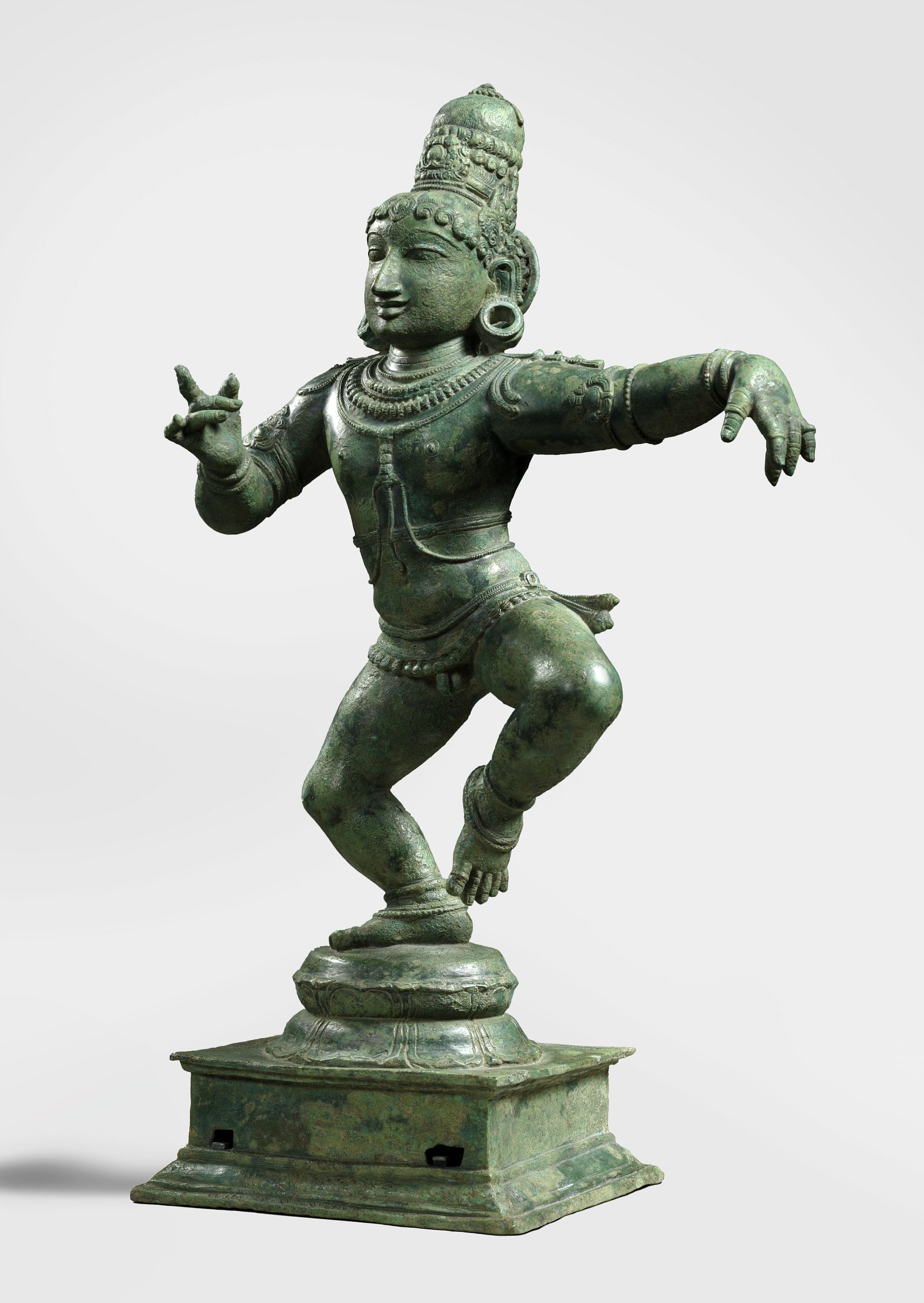 A statue of a child dancing.