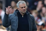 Jose Mourinho raises his hand in disgust on Manchester United sideline