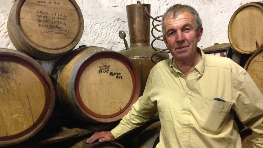 Peter Bignell standing in his whisky distillery in Kempton, southern Tasmania.