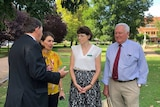 Four NSW politicians, including Premier Gladys Berejiklian, speaking in a park in Orange.