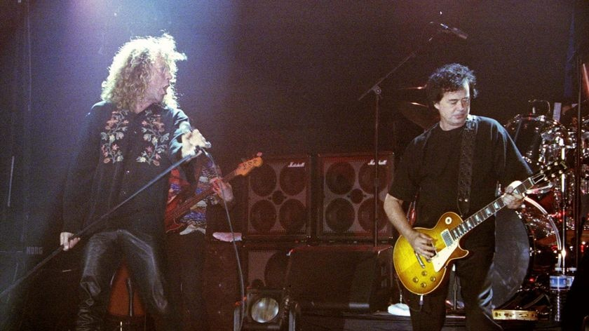 Robert Plant and Jimmy Page perform onstage