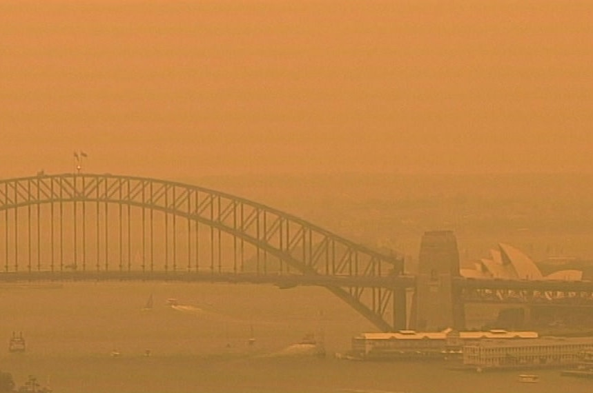 An eerie orange glow descended on Sydney Harbour late Friday afternoon.