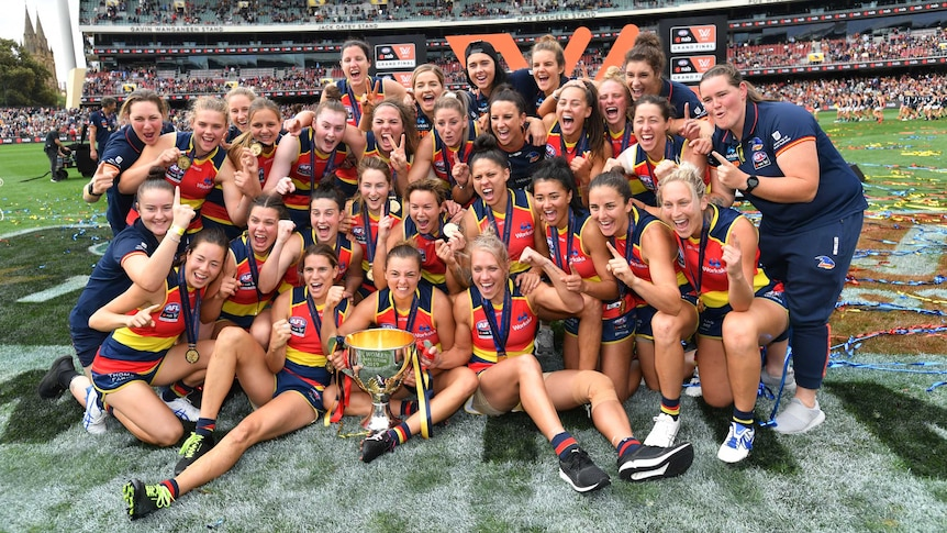 The Adelaide Crows celebrate with the AFLW Premiership cup