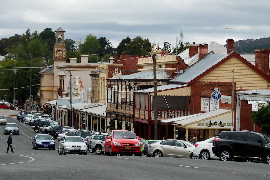 Looking down a country road with shops lining the street.