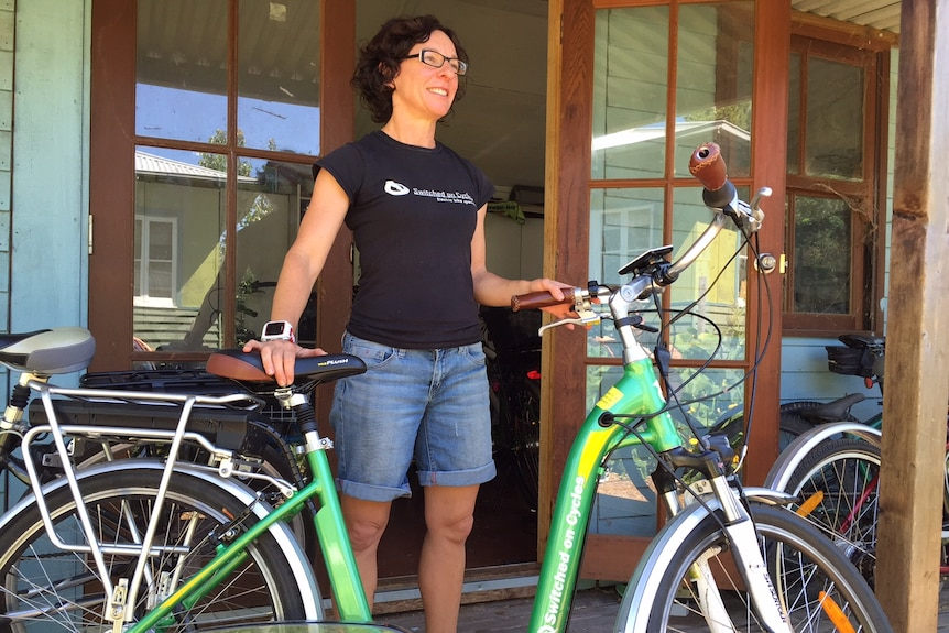 Bicycle retailer Simone Annis poses with an electronic bike.