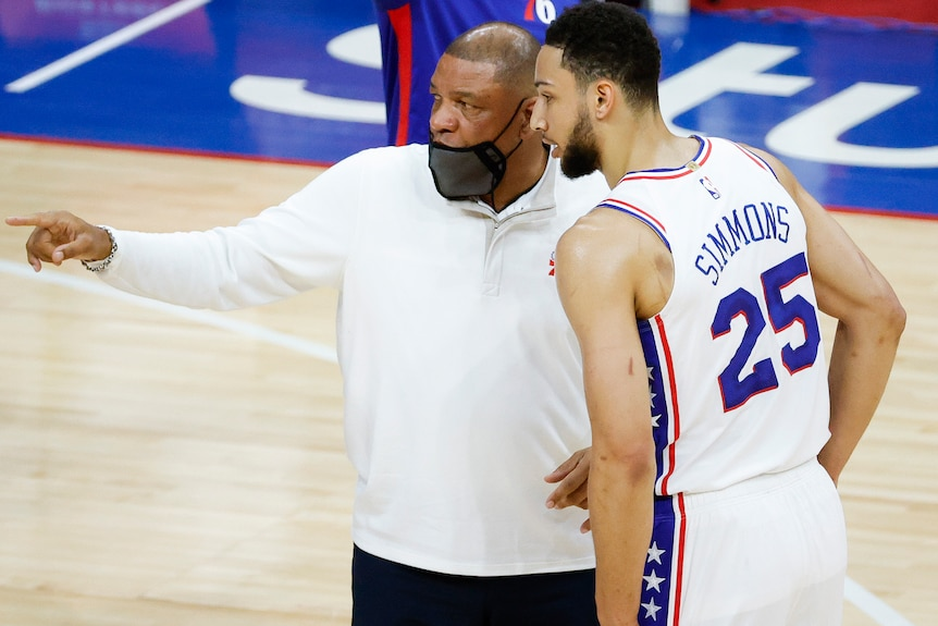 NBA coach talking with one of his players during  a match