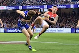 James Harmes takes a mark for the Demons at Docklands