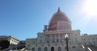 A ray of sunshine above the imposing historic Capitol Hill building in Washington.
