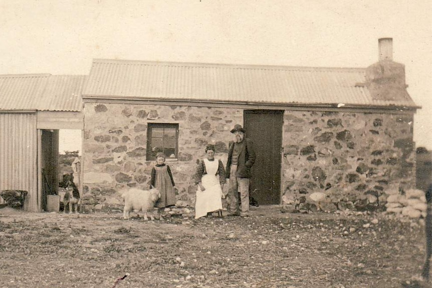 A historical photo of an old homestead