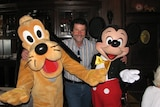 Former public servantIan Ralph Schapel with Pluto and Mickey Mouse