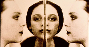 A mirror image shows women's faces.