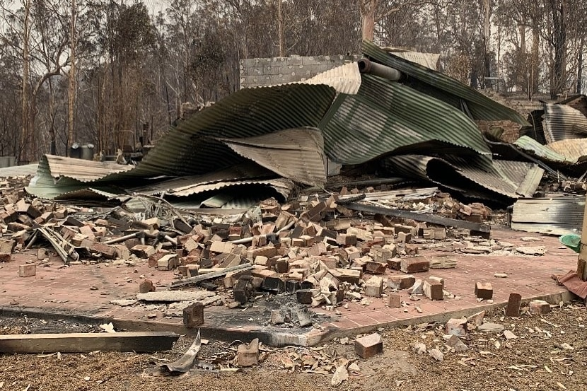 A destroyed small brick house.